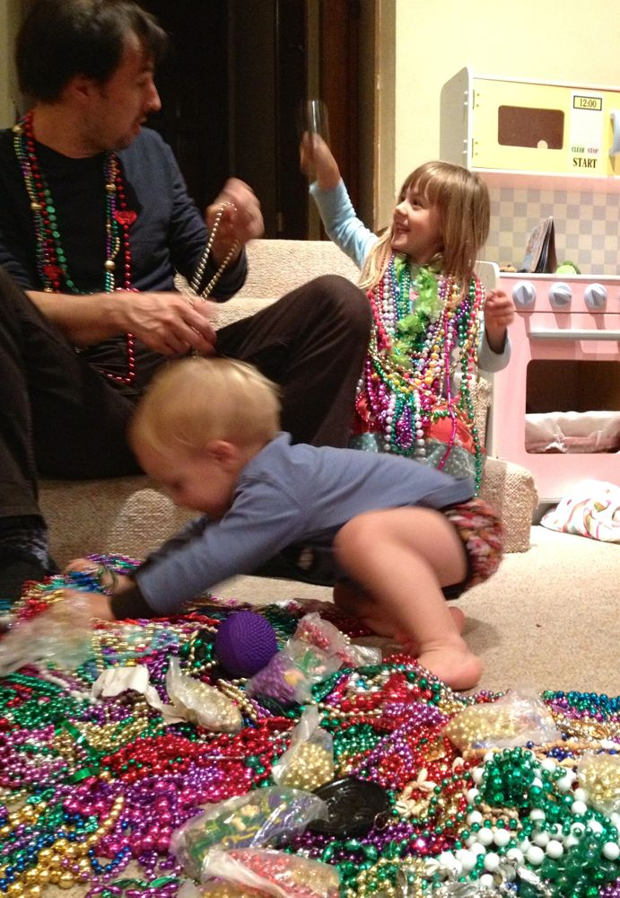 Madri Gras at our house is a blur of shiny beads and giggles!