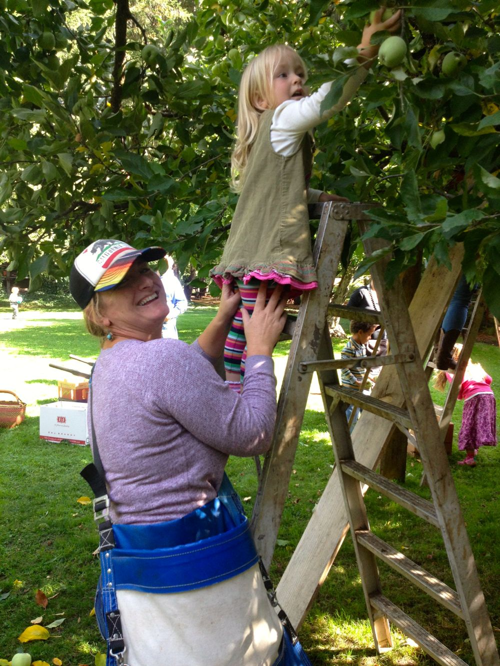 Georgia and Amy picking apples